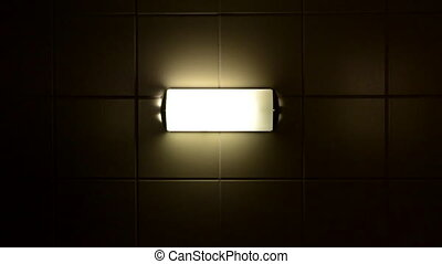 Creepy Light flickers - A creepy lamp flickers on a tile...