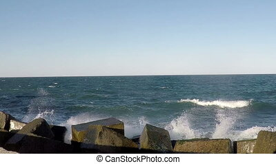 Surf at the Breakwater. - Sunny Day. Sea Waves Breaking on...