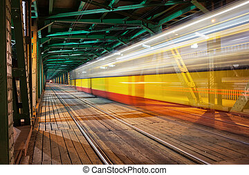 Tram Light Trail at Bridge in Warsaw - Tram light trail in...