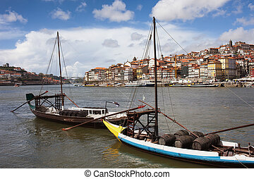 Boats with Wine Barrels on Douro River in Porto