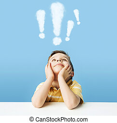 Boy with exclamation marks above head - Little boy with...
