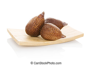 Tropical salak fruit. - Salak fruit on wooden plate isolated...