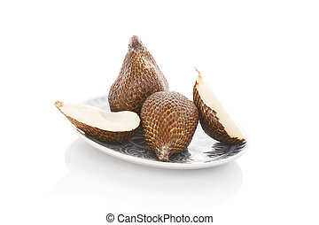 Salak fruit - Salak fruit on plate isolated on white...