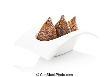 Tropical salak fruit - Salak fruit in bowl isolated on white...
