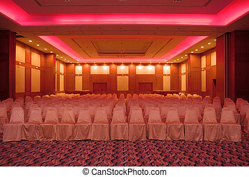 Conference Hall - Empty conference hall lit up with red...