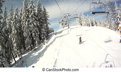 Skier rises on the ski lifts Around Panorama and landscapes...