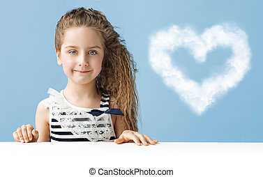 Little girl with a heart-shaped cloud - Little child with a...