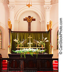 Altar - A church altar decorated with white flowers