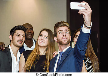 Group of multi-ethnic businesspeople taking a picture...