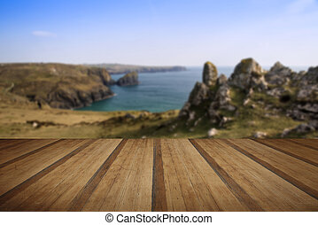 Kynance Cove cliffs looking across bay with wooden planks...