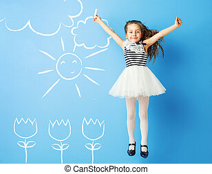Pretty girl making drawings on the wall - Pretty girl making...