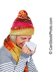 Young Woman Sneezing - Young woman in winter clothing,...
