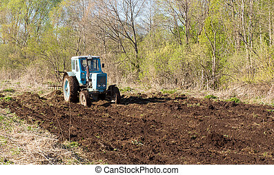 Tractor on a spring field