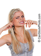 Young Woman Plugging Ears - A young woman plugging her ears...