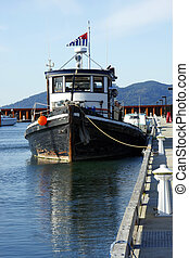 A lobster boat. - A fishing lobster boat moored at the...