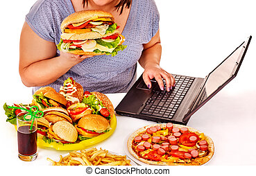 Woman eating junk food. - Body part of woman eating fast...