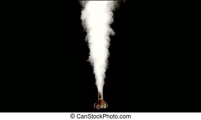Chemistry experiment with smoke coming from the flask on a...