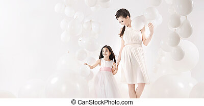 Mother and daughter spending together their leisure time -...