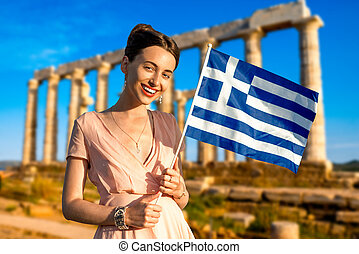 Woman with Greek flag on ancient ruins background - Woman...
