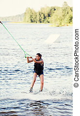 Woman study riding wakeboard