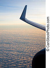 View from airplane - View on sunset with clouds from...