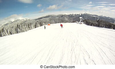 Skier rides on the ski slopes First-person view - A skier...