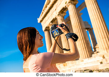Woman photographing Parthenon temple in Acropolis - Young...