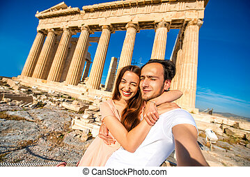 Young couple taking selfie picture with Parthenon temple on...