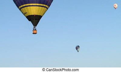Hot air balloons on background of cloudless sky - Colorful...