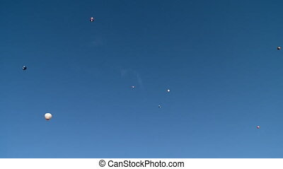 View of hot air balloons in clear blue sky