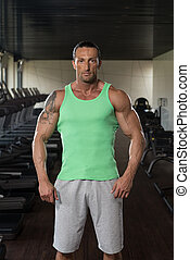 Portrait Of A Man In Modern Gym - Portrait Of A Physically...