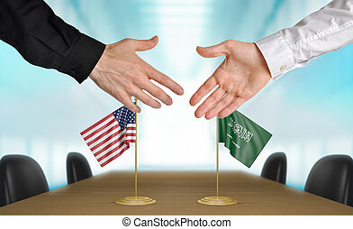 United States and Saudi Arabia diplomats agreeing on a deal.