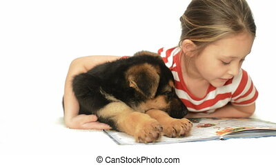 girl with a puppy reading