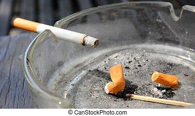 Cigarette in the ashtray - Closeup of the burnt cigarette...