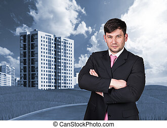 Businessman outdoors looking at camera Buildings on...