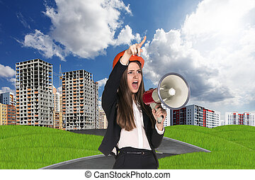 Woman in hardhat screaming in megaphone