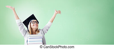 happy student in mortar board cap with books - education,...