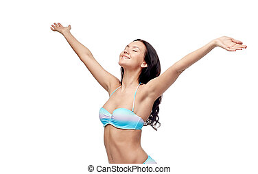 happy woman in bikini swimsuit with raised hands - people,...