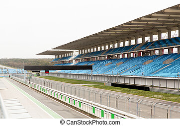 empty speedway and bleachers on stadium - racing,...