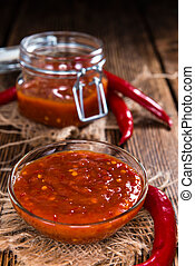 Homemade Sambal Oelek (close-up shot) on wooden background