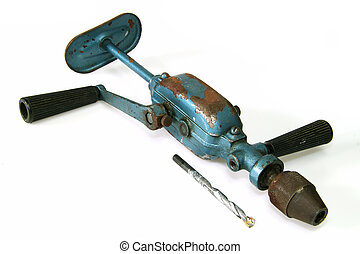 Hand drill - Old hand drill on bright background