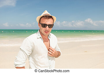 Attractive young man posing on the beach