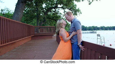 Young couple together in a park - Young couple, in love, in...