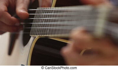 european man plays guitar on fingerboard - european man in...