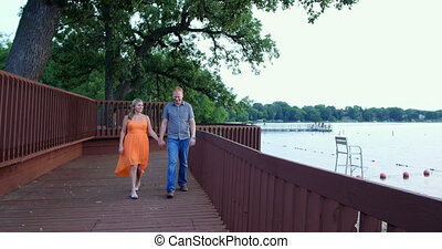 Young couple together in a park. - Young couple, in love, in...