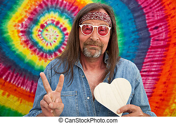 Hippie middle-aged man making the victory sign - Hippie...