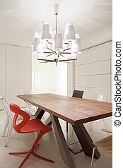 Dining space - Wooden table in elegant dining space in...