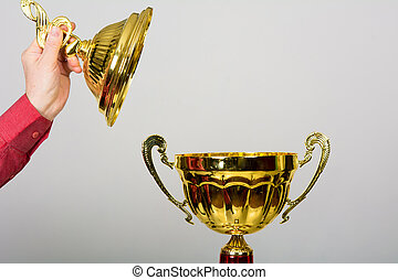 Gold Cup trophy for winning the Song Festival. The hand...