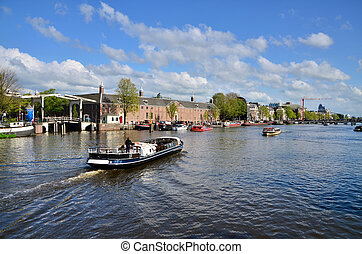 Houses and Boats on Amsterdam Canal, Amsterdam is the...