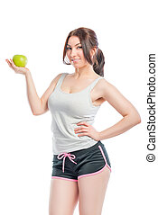 attractive girl in the sports form with green apple